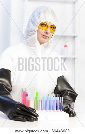 young woman wearing protective coat in laboratory