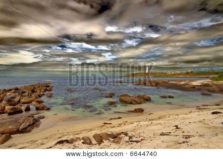 Lighthouse Set Against A Surreal Sky