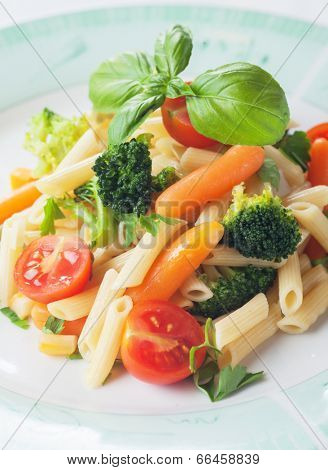 Pasta primavera, penne rigate with broccoli and other vegetables