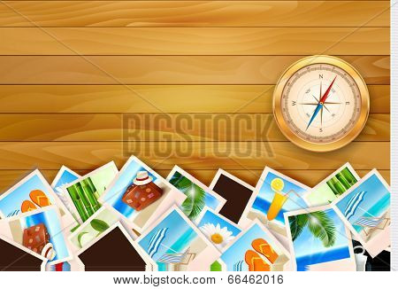 Travel photos and compass on wood background.