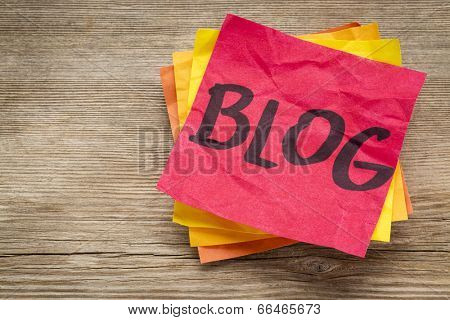 blog word on a sticky note against grained wood