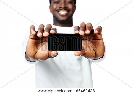 African man showing a blank smartphone display isolated on a white background. Focus on smartphone