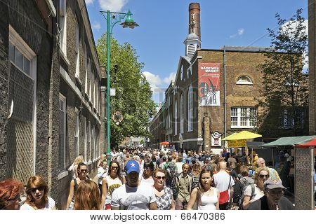 Tourists In Brick Lane On A Busy Sunny Sunday