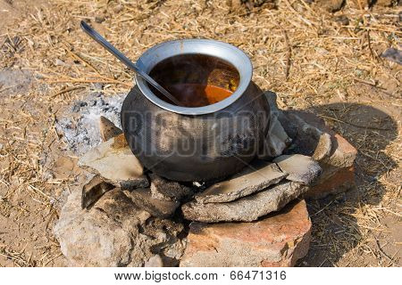 Metal  Pot With Food On Fire, India