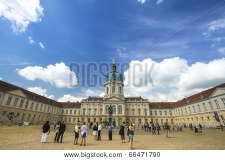 BERLIN, GERMANY - MAY 24, 2014: View of Charlottenburg Palace, is the largest surviving royal palace in Berlin. The main entrance to castle has a 48-meter dome, topped by a gilded statue of Fortune.