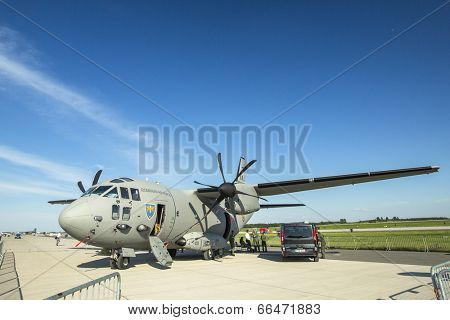 BERLIN, GERMANY - MAY 21, 2014: Military transport aircraft Romanian Air Force Alenia C-27J Spartan, demonstration at International Aerospace Exhibition ILA Berlin Air Show-2014.