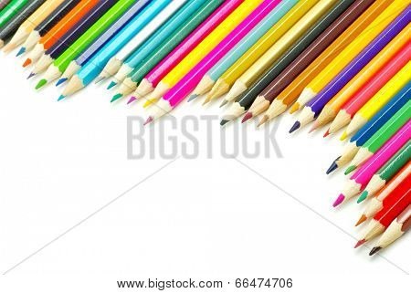 Assortment of coloured pencils  on white background
