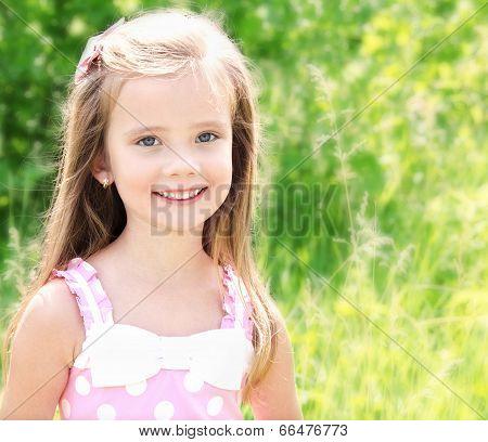 Portrait Of Adorable Smiling Little Girl
