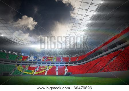 Digitally generated portugese national flag against football stadium with fans in white