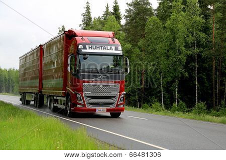 Red Volvo FH16 Truck On Summer Highway