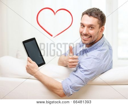 technology, home and lifestyle concept - smiling man working with tablet pc computer at home showing thumbs up
