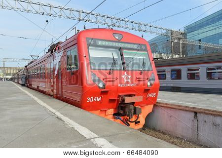 MOSCOW - MARCH 30:  Aeroexpress red train on Paveletsky station on March 30, 2014 in Moscow. Aeroexpress Ltd. is the operator of air rail link services in Moscow, Russia
