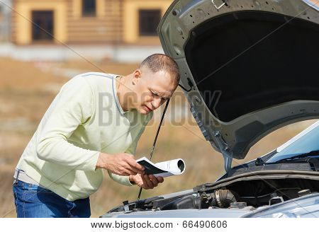 man and car