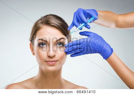 Beautiful woman with plastic surgery plastic surgeon hands