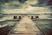 stock photo of darkness  - Old wooden jetty - JPG