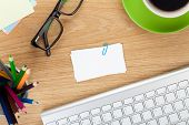 stock photo of blank  - Blank business cards over office table with supplies - JPG