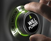 stock photo of goal setting  - Fingers turning a willpower button and setting it on the highest position green tones - JPG