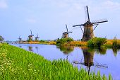 picture of windmills  - Dutch windmills with canal reflections at Kinderdijk - JPG
