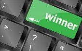 image of raffle prize  - winner button on the keyboard key close - JPG