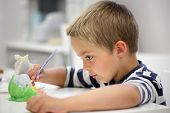 image of finger-painting  - Child painting a ceramic pottery model at school concept for art and creative education - JPG
