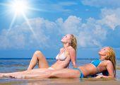 stock photo of denude  - In Bikini on a Beach Relaxating  - JPG