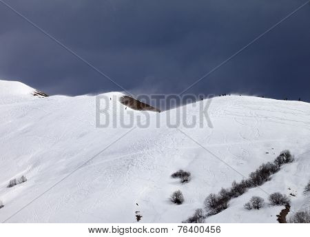 Off Piste Slope And Overcast Gray Sky In Windy Day