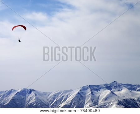 Paraglider Silhouette Of Mountains In Sunlight Sky