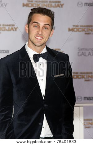 m LOS ANGELES - NOV 17:  Cody Johns at the The Hunger Games: Mockingjay Part 1 Premiere at the Nokia Theater on November 17, 2014 in Los Angeles, CA