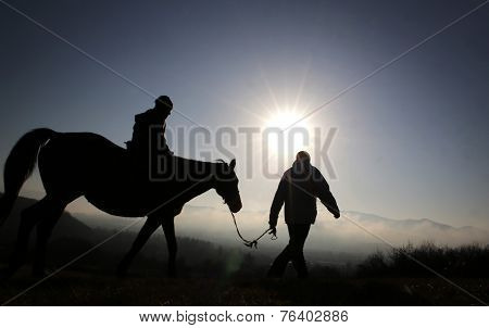 A Child On A Horse Ride In The Mountain