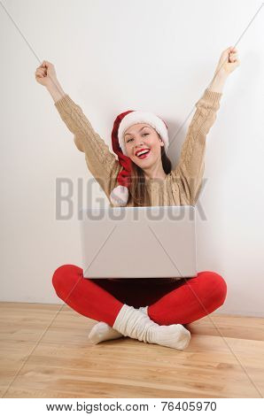 Happy Young Woman In Santa Hat Searching Online Presents For Christmas