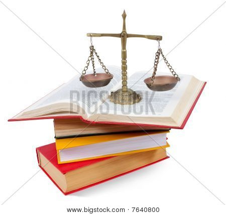 Scales Of Justice Atop Legal Books
