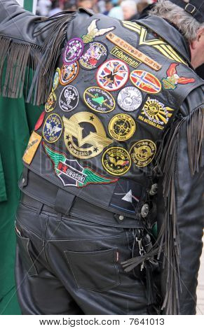 A leather clad biker at a motorcycle meet-up