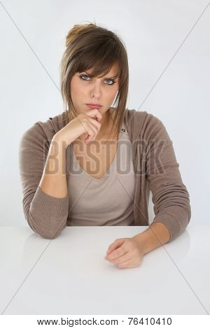Portrait of young woman being skeptical, isolated