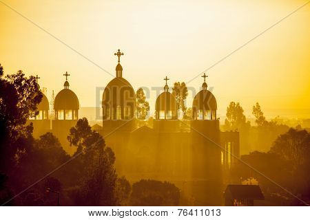Ethiopian orthodox church with sunrays in Addis Ababa at dawn