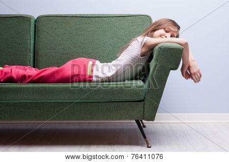 Little Girl Softly Sleeping On A Green Sofa