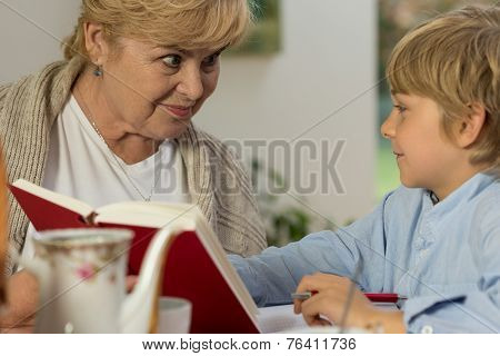 Senior Babysitter Caring About Schoolboy