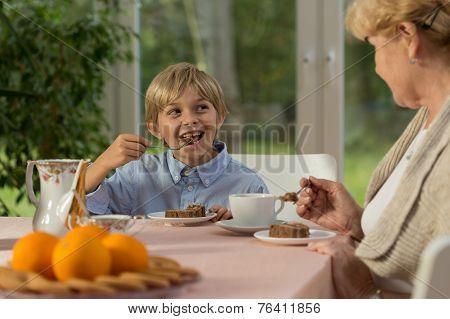 Boy Eating Tasty Cake