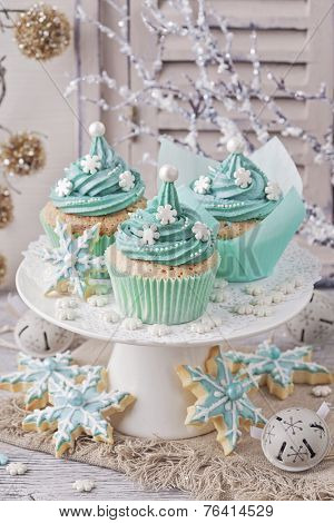 Pastel colored cupcakes on a white wooden background
