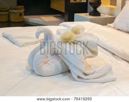Bed Suite Decorated With Flowers And Swan Towel