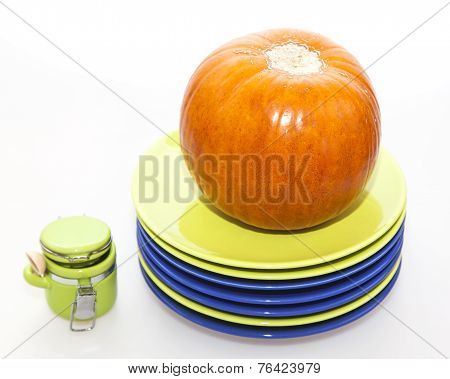 Orange pumpkin and ware for table layout