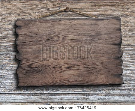 old wood plank or plate hanging on timber plank wall background
