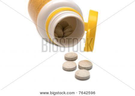 Pills Spilling Out Of A Prescription Bottle