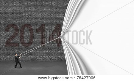 Businessman Pulling Down White Curtain Covering Old 2014 Brick Wall