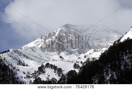 A Rocky And Snow-capped Mountain Top