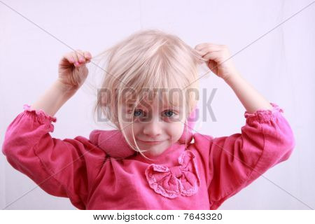 Little blonde girl in a pink dress