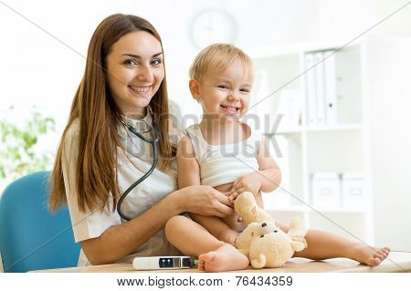 medic pediatrician examining of child with stethoscope