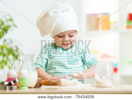 smiling baker kid girl in chef hat