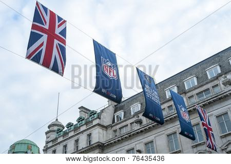 LONDON, UK - SEPTEMBER 27: Union Jack and NFL banners hanging in Regent street. September 27, 2014 in London. Regent street was closed to traffic to host NFL related games and events.
