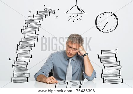 Tired Businessman Working and Studying Till Late In Office