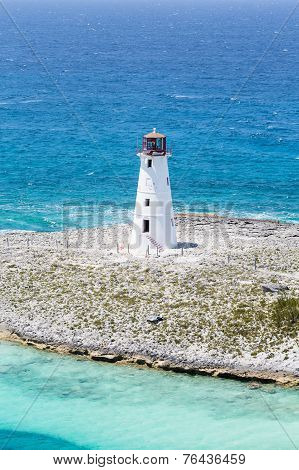 Small White Lighthouse On Spot Of Land
